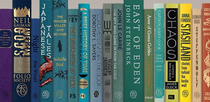 Folio books in rainbow coloured order