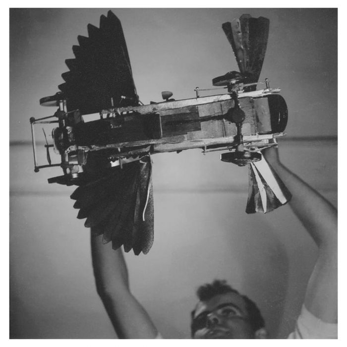 John Burningham holding aloft his handmade model of Chitty-Chitty-Bang-Bang (c .1963)