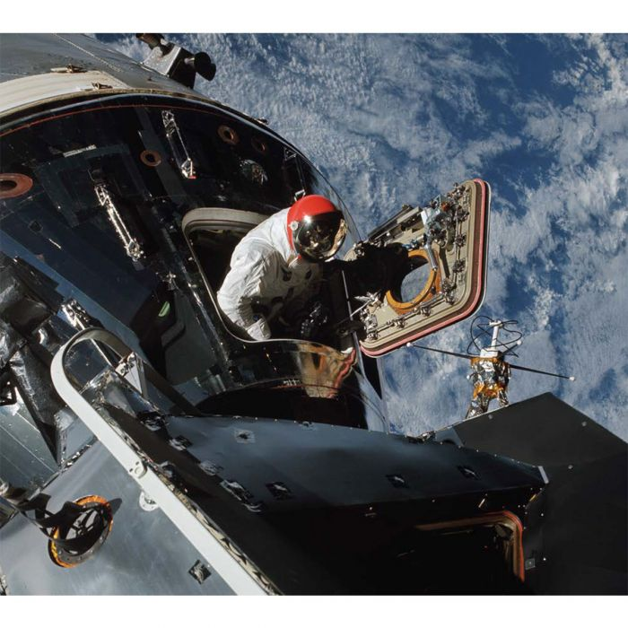 Dave Scott floats in the hatch of the command module Gumdrop during his spacewalk with Schweickart, who took this photo. Courtesy NASA and Andrew Chaikin